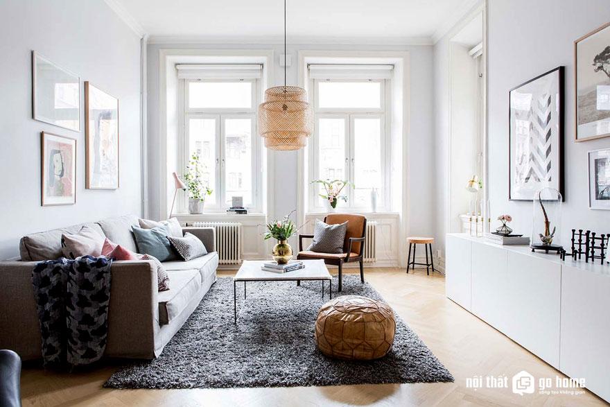 Phòng khách theo phong cách scanadinavian được trải thảm trải sàn màu xám nhạt (Ảnh: Internet)