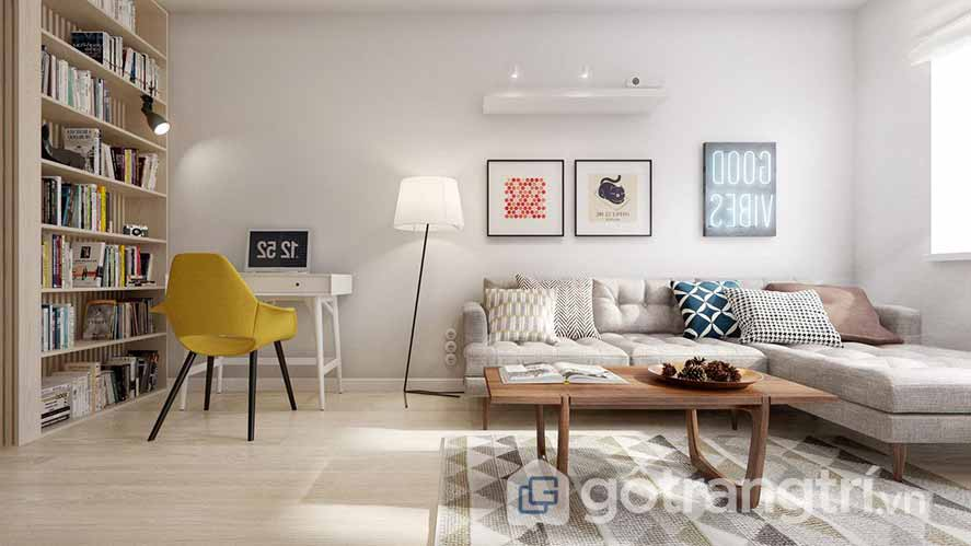 Căn phòng khách này được trang trí khá giản đơn, với ghế ngồi màu vàng, ghế sofa màu xám, và thảm trải họa tiết khá bắt mắt (Ảnh: Internet)