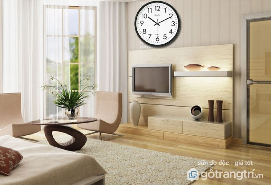 Treo đồng hồ ở bức tường phía trên tivi cũng là một ý tưởng tuyệt vời (Ảnh: Internet)