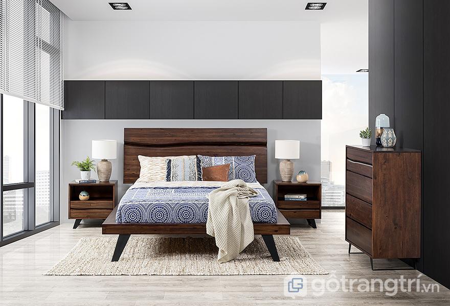 Bố trí giường ngủ theo phong thủy nên kê 1 đầu giường sát vào tường để tạo được thế vững chắc