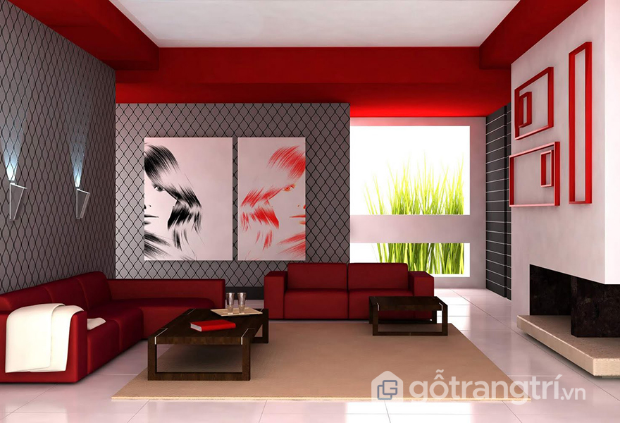 Phòng khách màu đỏ tạo nên nét riêng biệt cho căn hộ này