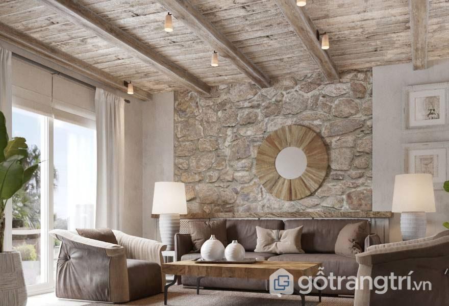 Phòng khách được ốp tường với đá tự nhiên hài hòa với bộ ghế sofa, trần nhà (Ảnh: Internet)