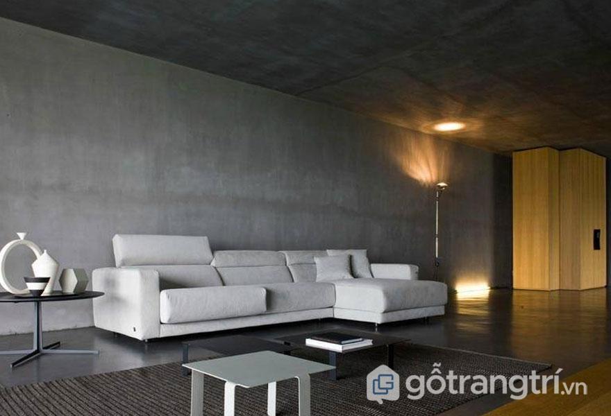 Căn phòng khách trở nên sang trọng hơn với màu sơn tường giả bê tông nhẵn mịn, sáng loáng - Ảnh: Internet