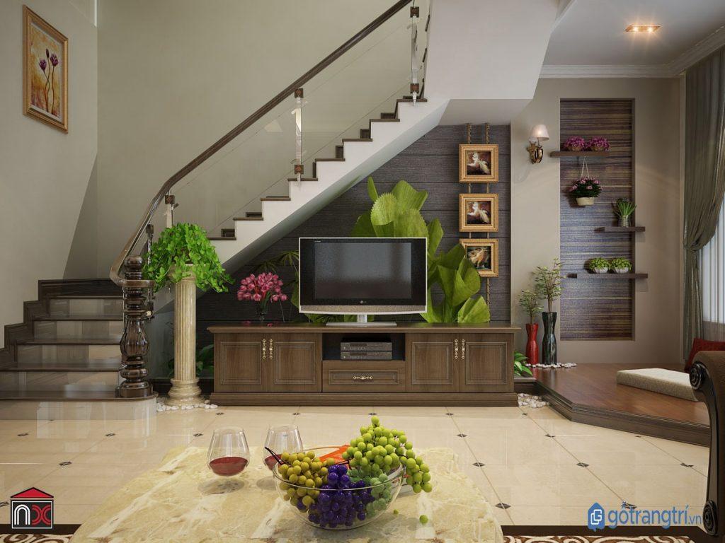 Trang trí chân cầu thang bằng tủ ti vi đẹp mắt và tiện nghi. (ảnh: internet)