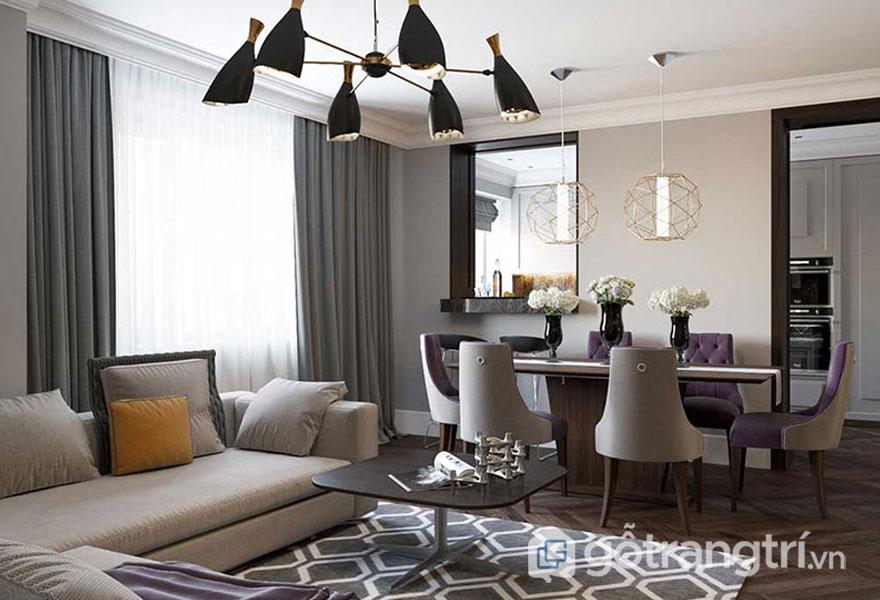 Sàn gỗ bóng kết hợp thảm trải hình học làm nổi bật thiết kế Art Deco cho phòng khách (Ảnh: Internet)