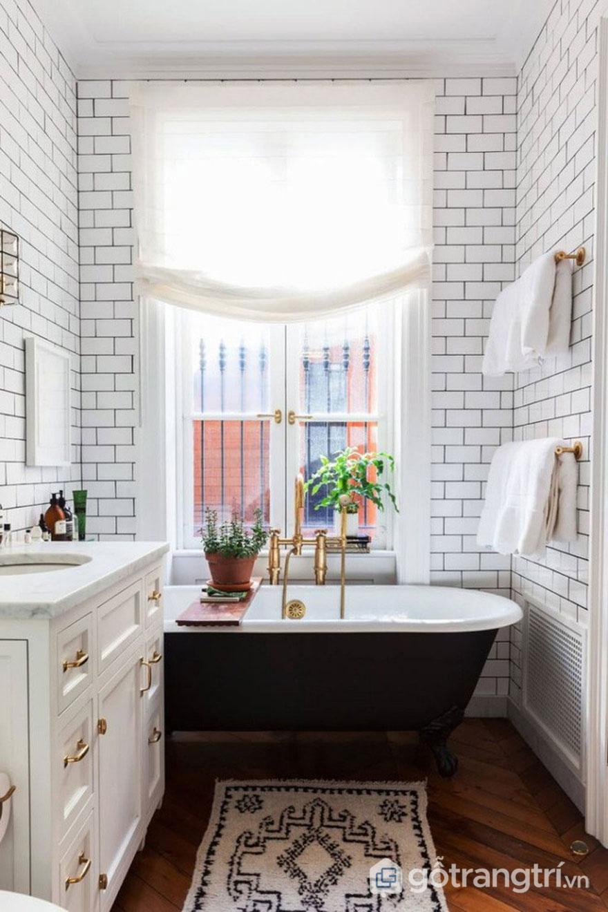 Gạch ốp màu trắng viền đen và thảm trải họa tiết đặc trưng trong phong cách thiết kế Art Deco (Ảnh: Internet)