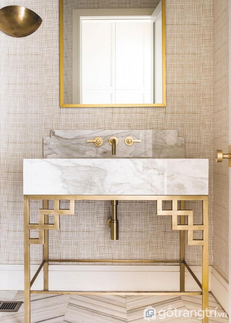 Đá cẩm thạch kết hợp với đồng thau theo những đường nét hình học của thiết kế Art Deco (Ảnh: Internet)