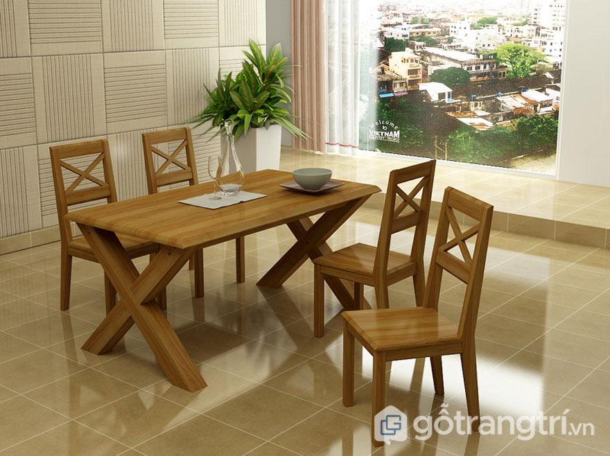 Bàn ăn làm từ gỗ sồi tự nhiên với chân bàn hình chữ X (Ảnh: Internet)