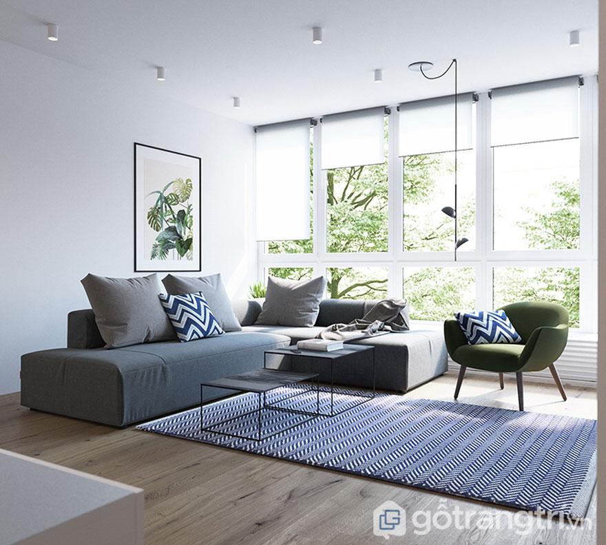 Ghế sofa màu xám, thảm trải sàn kẻ sọc xanh tạo sự cá tính cho phòng khách (Ảnh: Internet)