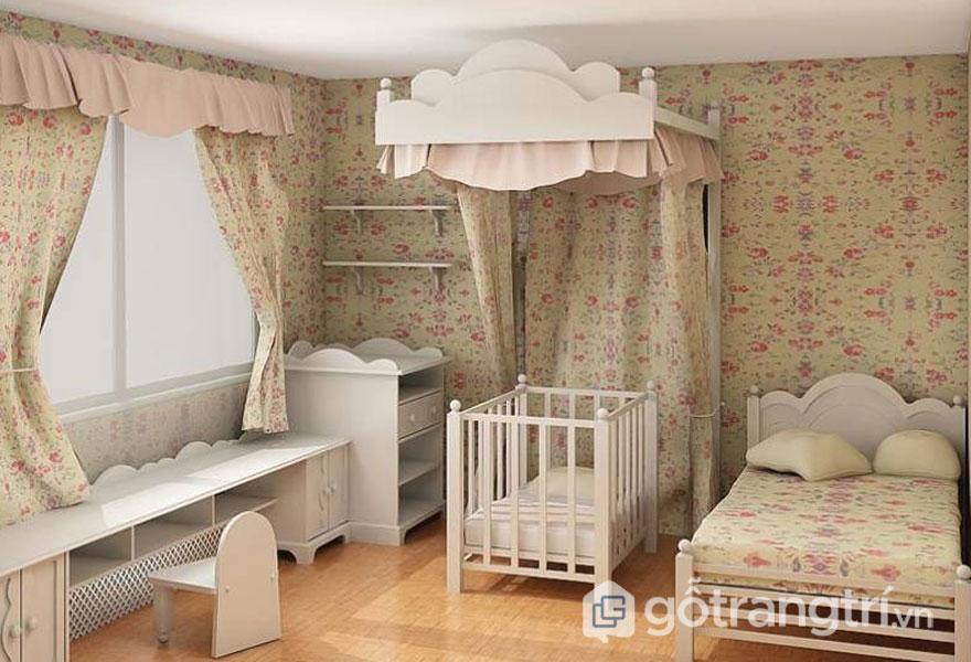 Phòng ngủ bé gái là trẻ sơ sinh với phụ kiện họa tiết vàng nhạt và nội thất màu trắng (Ảnh: Internet)