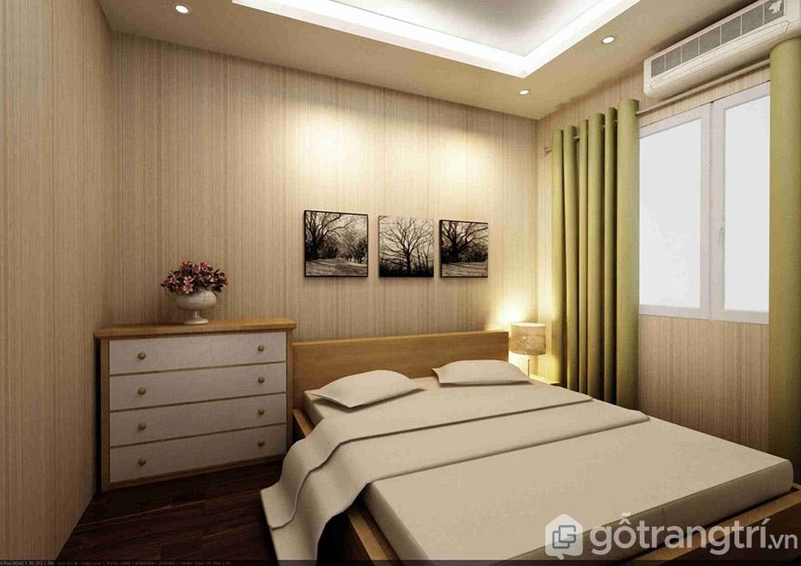 Thiết kế nội thất phòng ngủ chỉ với kệ để đồ, giường và tranh trang trí