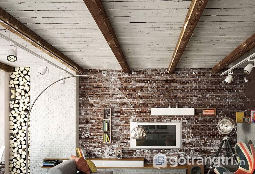 Một bức tường gạch màu đỏ đã loang lổ bởi những vệt trắng của sơn - Ảnh: Internet