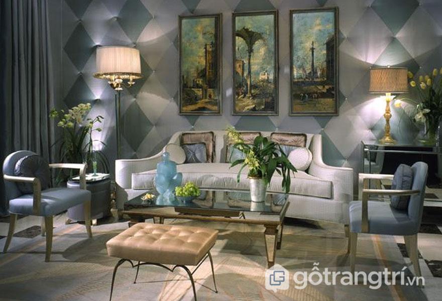 Phòng khách nổi bật với ánh sáng huyền ảo của đèn để bàn, dòng tranh nghệ thuật đặc sắc (Ảnh: Internet)