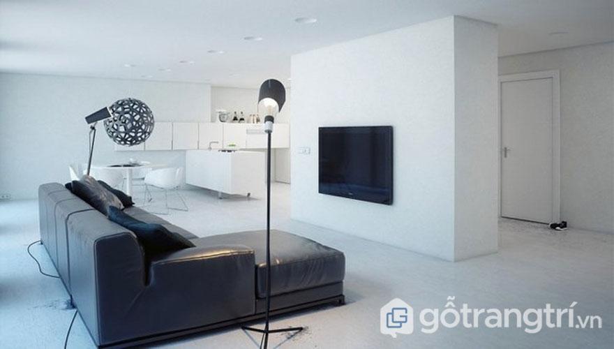 Màu đen là gam màu hay được sử dụng trong phong cách nội thất tối giản. Chiếc TV đen, ghế bành da màu đen và cả chiếc đèn trần hình cầu cũng màu đen tạo sự sang trọng cho căn phòng (Ảnh: Internet)
