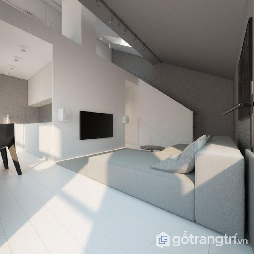 Những đường viền màu trắng, đen và xám khi kết hợp với nhau tạo nên không gian phòng khách khá hiện đại, sang trọng. Bức tường, ghế ngồi bằng cotton hay sàn gỗ đã tạo sự khác biệt cho ngôi nhà này (Ảnh: Internet)