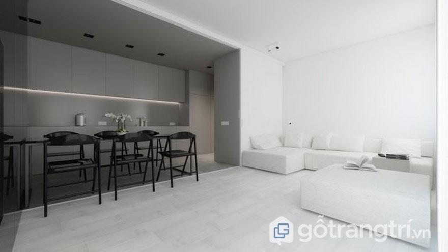 Căn phòng này được trang trí khá tối giản khi sự xuất hiện của gam màu trắng tinh khôi qua bộ ghế sofa và màu xám của bộ ghế bàn ăn (Ảnh: Internet)
