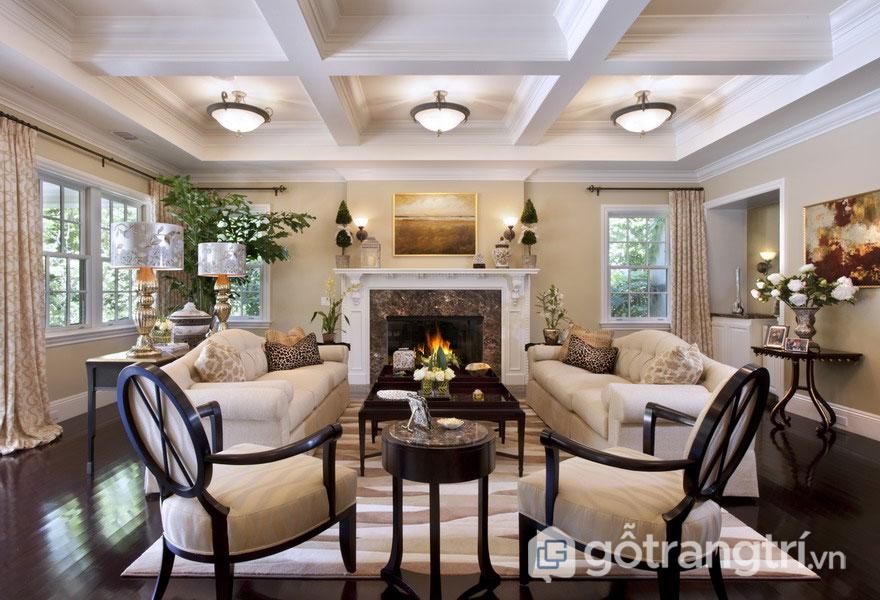 Nhà phong cách tân cổ điển cho phòng khách được sử dụng gam màu nâu trầm ấm áp (Ảnh: Internet)