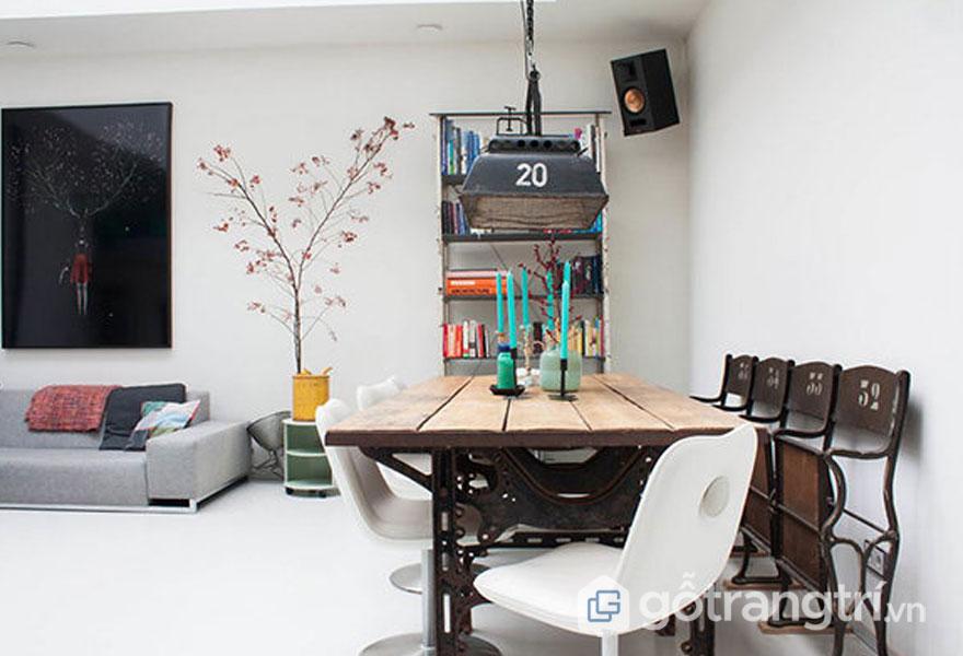 Việc đặt 1 bộ bàn ăn được làm từ dòng chất liệu thô với kiểu dáng khá bụi mang đến 1 không gian cuốn hút chứ nhỉ? (Ảnh: Internet)