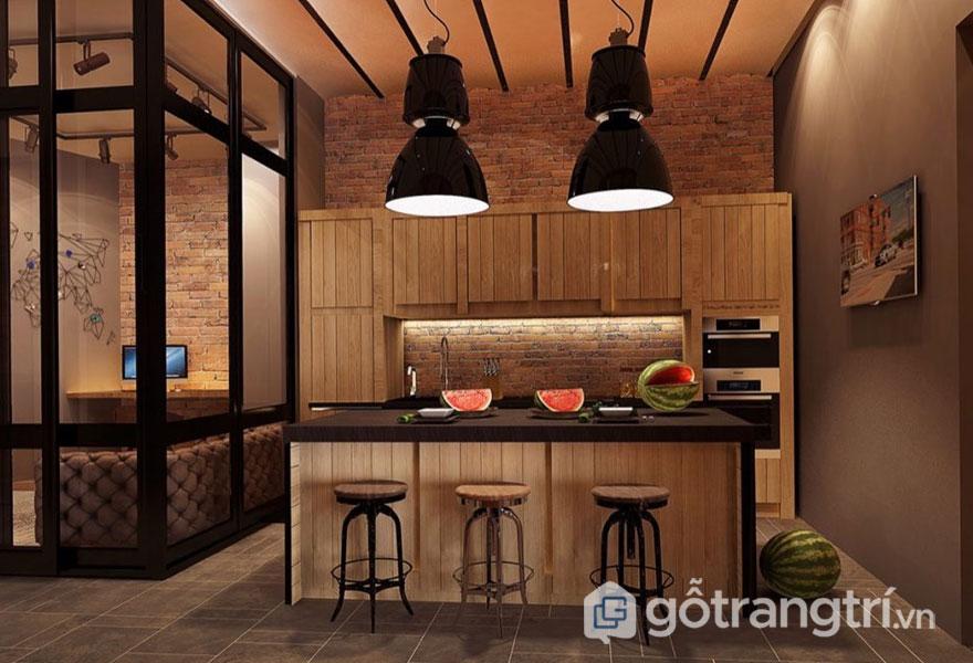 Đèn công nghiệp thả trần đã mang đến ánh sáng ấm cúng hòa trộn với tông màu nâu từ tủ bếp (Ảnh: Internet)