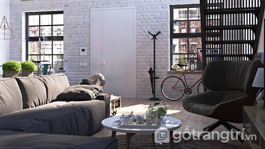 Căn phòng này vẫn để lộ bức tường gạch nguyên trơ nhưng chúng lại được sơn với gam màu trắng (Ảnh: Internet)