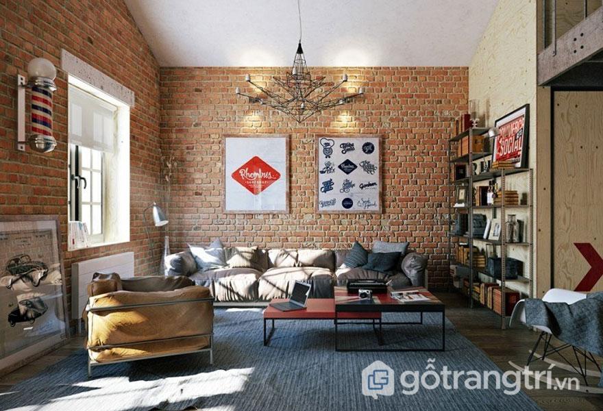 Phòng khách bài trí phong cách nội thất công nghiệp với mảng tường gạch thô sơ đan xen bức tranh treo tường đơn giản (Ảnh: Internet)
