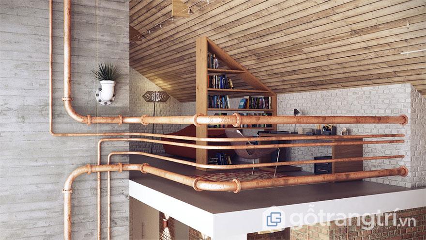 Căn gác xép được trang trí bằng đường ống với chức năng làm vách ngăn (Ảnh: Internet)