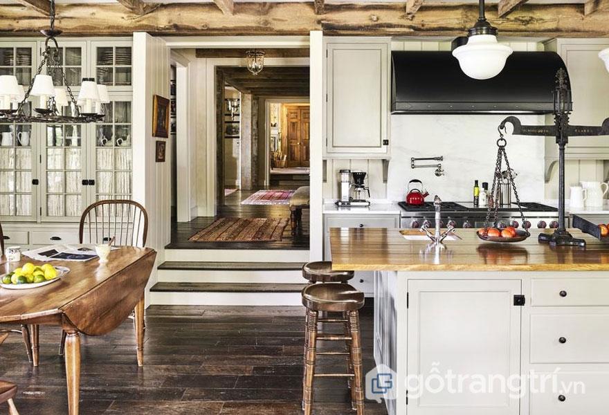 Phòng bếp phong cách Rustic sử dụng chất liệu gỗ thô mộc vời nền trắng tạo sự phóng khoáng, ấm áp (Ảnh: Internet)
