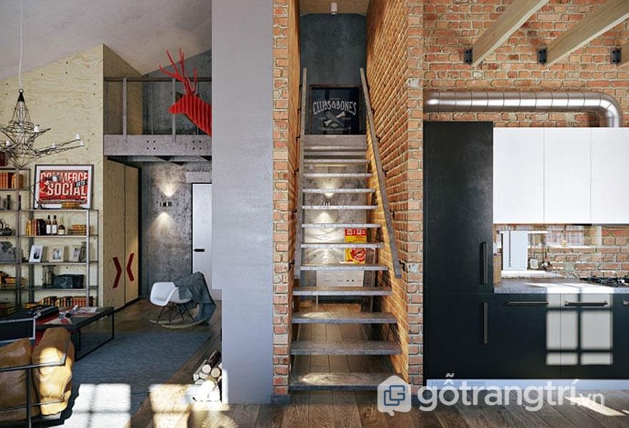 Đường ống dẫn kim loại được để lộ trên mảng tường gạch, hệ thống cầu thang dẫn lên gác xép (Ảnh: Internet)