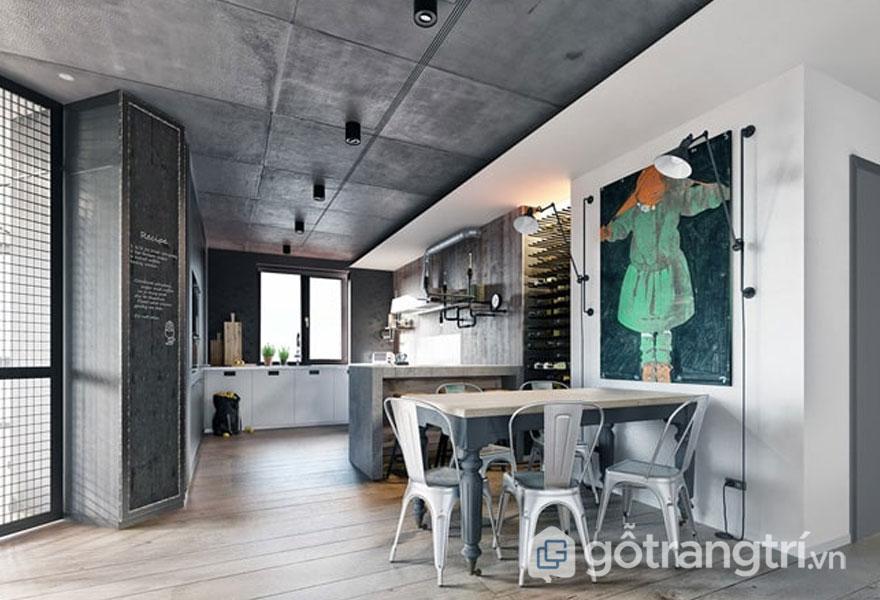 Bộ bàn ăn làm từ kim loại, với tranh treo tường khá nghệ thuật (Ảnh: Internet)