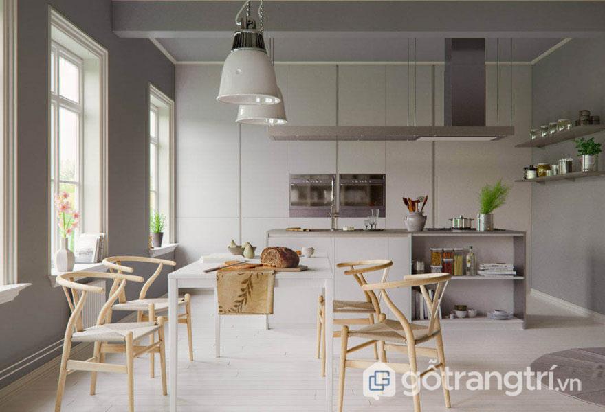 Phòng ăn được trang trí theo kiểu vintage với màu xám đặc trưng, nổi bật là bộ bàn ghế gỗ Wishbone đơn giản, nhẹ nhàng (Ảnh: Internet)