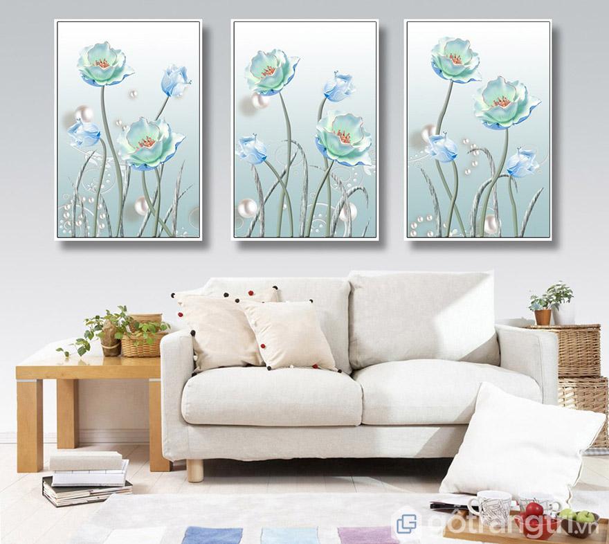 Màu xanh ngọc nhẹ nhàng tạo nên sự lãng mạn, thư thái cho không gian phòng khách.