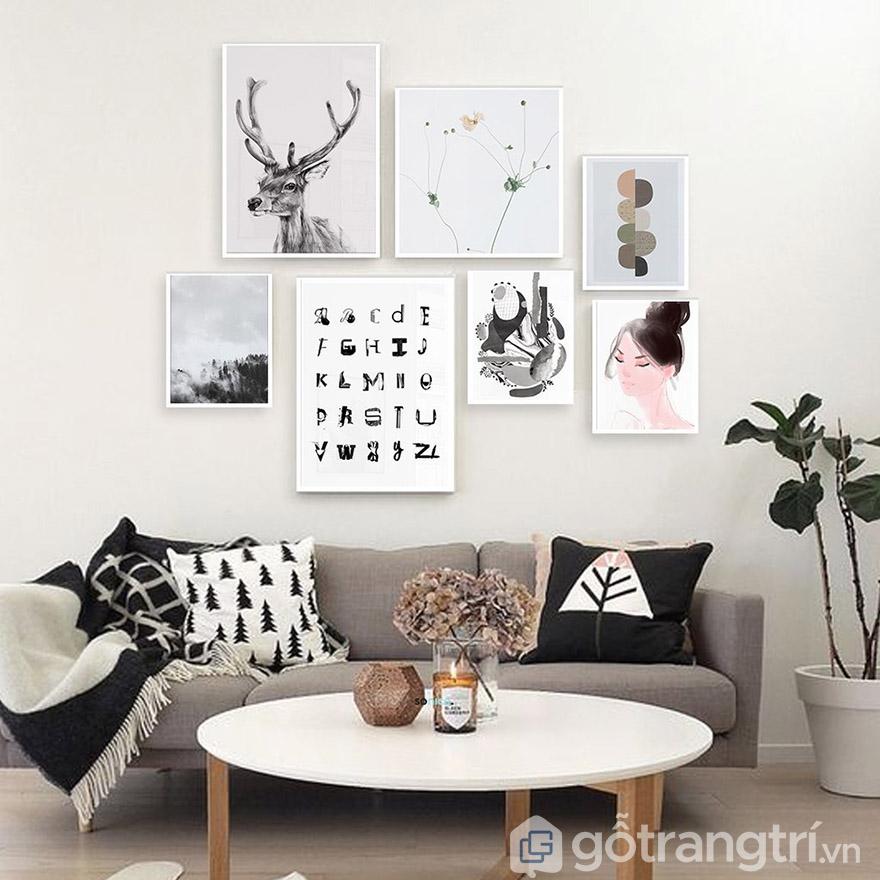 Treo tranh nằm trọn trong chiều dài sofa là bạn có thể tùy ý sáng tạo.