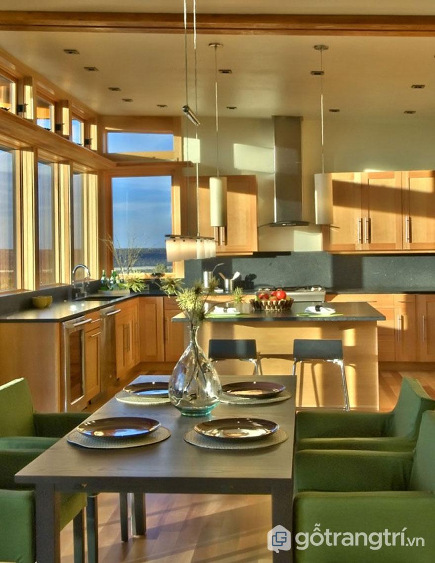 Phòng bếp bài trí khá nhẹ nhàng với hai tông màu xanh cốm - nâu (Ảnh: Internet)
