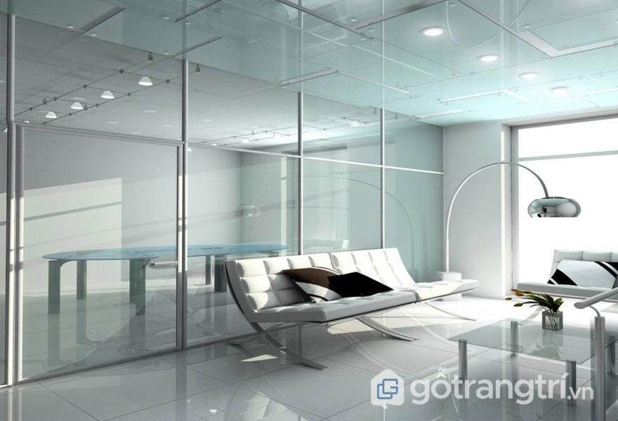 Phòng làm việc với ghế sofa màu trắng và hệ thống cửa kinh ốp trần, tường (Ảnh: Internet)