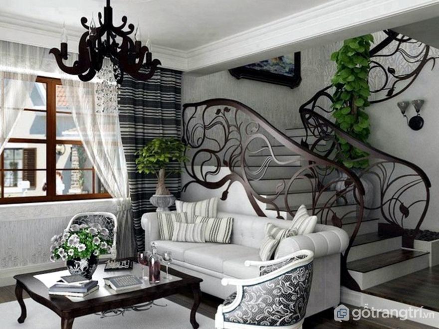 Phòng khách nổi bật với đường cong quyến rũ của cầu thang (Ảnh: Internet)