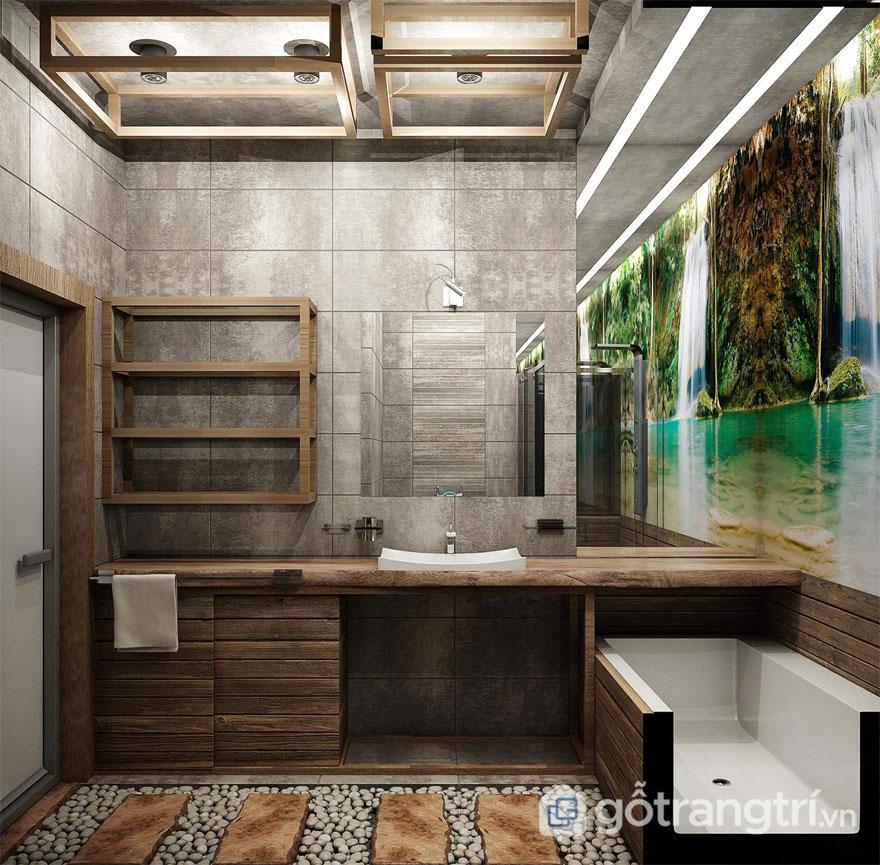 Phòng tắm được bài trí theo phong cách Eco luôn mang đến sức sống gần gũi vơi thiên nhiên khi tường ốp gắn tranh phong cảnh, nền nhà lát sỏi đó, và tấm gỗ dài (Ảnh: Internet)