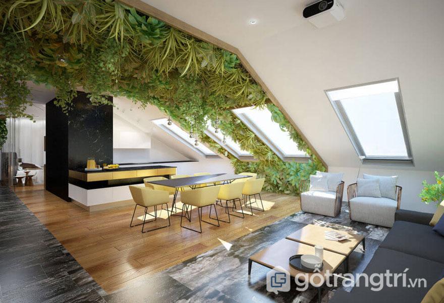 Phòng ăn và phòng khách liền kế với sự xuất hiện của cây xanh trên vòm mái khá ấn tượng (Ảnh: Internet)