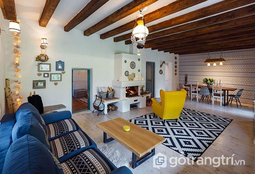 Thiết kế nội thất phong cách truyền thống phòng khách nổi bật gam màu xanh và vàng tươi (Ảnh: Internet)