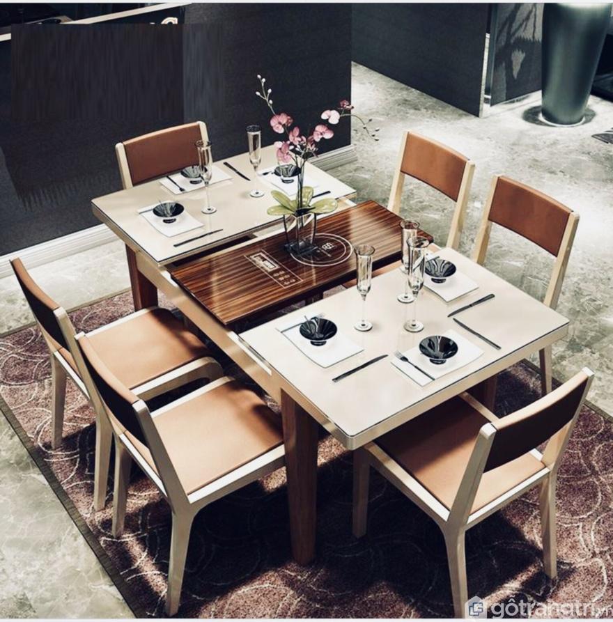 Đây là một trong những mẫu bàn ăn thông minh nhất hiện nay, có hệ thống bếp từ ngay trên mặt bàn giúp bạn có thể vừa nấu nướng vừa thưởng thức món ăn ngay tại bàn ăn. (Ảnh: Internet)