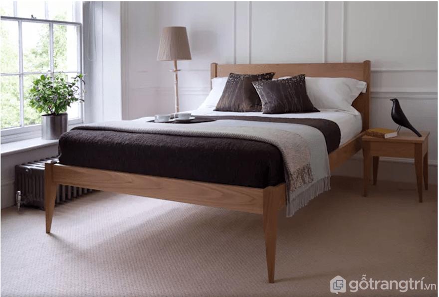 Giường gỗ đơn giản làmtừ gỗ tự nhiên - Ảnh: Internet