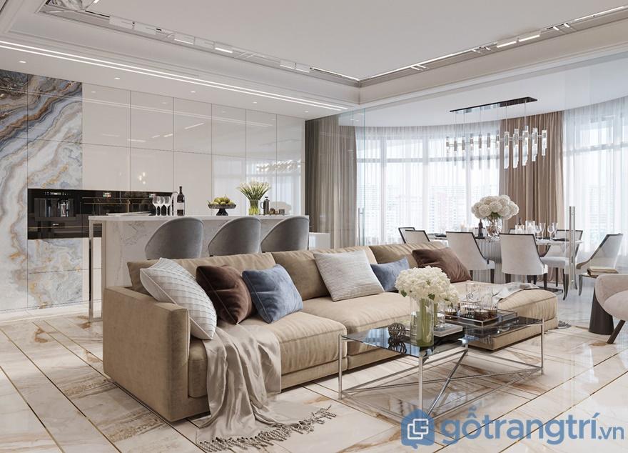 Phòng khách trở nên thoáng rộng hơn khi được bố trí bằng cửa kính trong suốt và gần ban công rộng lớn