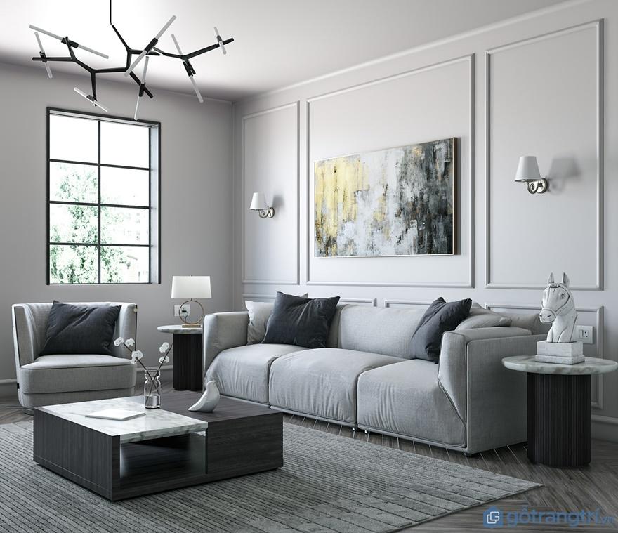 Ghế sofa phòng khách được làm từ chất liệu nỉ với tông màu ghi mang đến sự nhã nhặn, thanh tao cho phòng khách