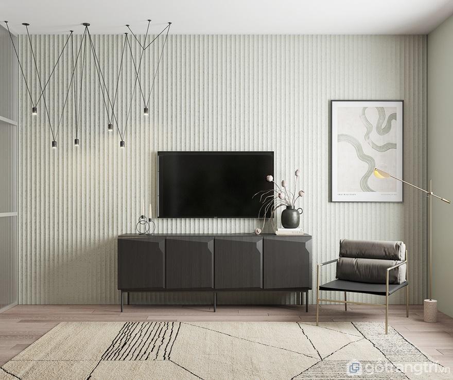 Phòng khách được bố trí tivi treo tường để gia đình có những giây phút thảnh thơi xem phim cùng nhau