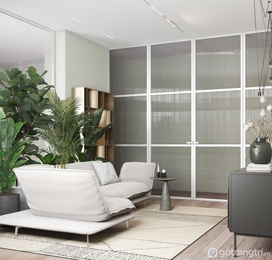 Và đừng quên đưa không gian xanh vào phòng khách bằng những chậu cây cảnh xanh mướt đặt sau ghế sofa