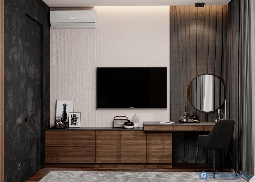 Phòng ngủmasterđược bố trí thêm bàn trang điểm và tivi treo tường đối diện giường ngủ
