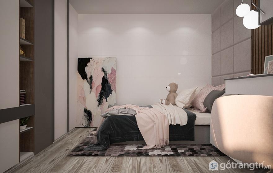 Để không gây sự nhàm chán, phòng ngủ bé gái được bố trí thêm bức tranh đặt ngay cạnh góc phòng ngủ
