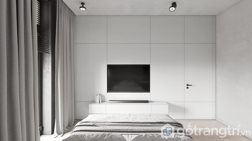 Đối diện giường ngủ đó chính là chiếc tivi treo tường để gia chủ có thể xem chương trình trực tuyến