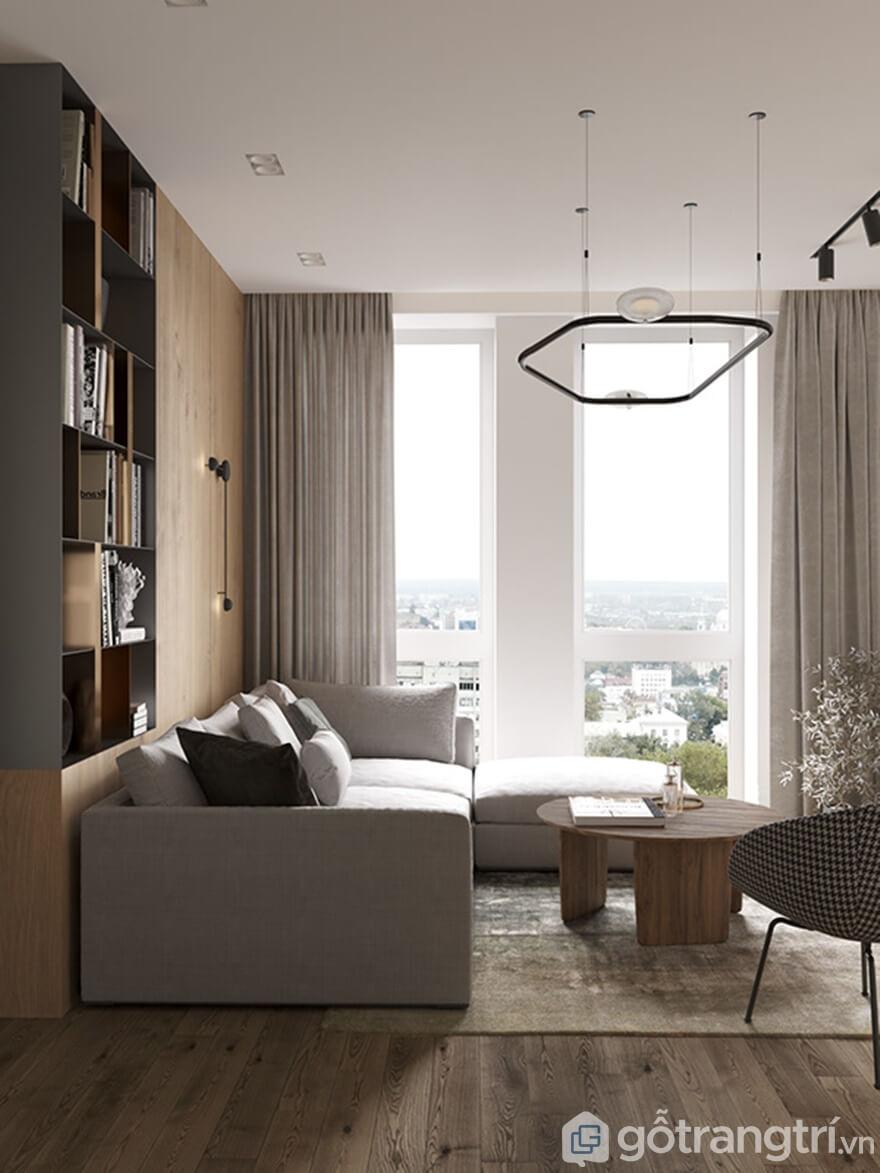 Phòng khách được bố trí cạnh ban công để đưa ánh sáng tự nhiên vào phòng