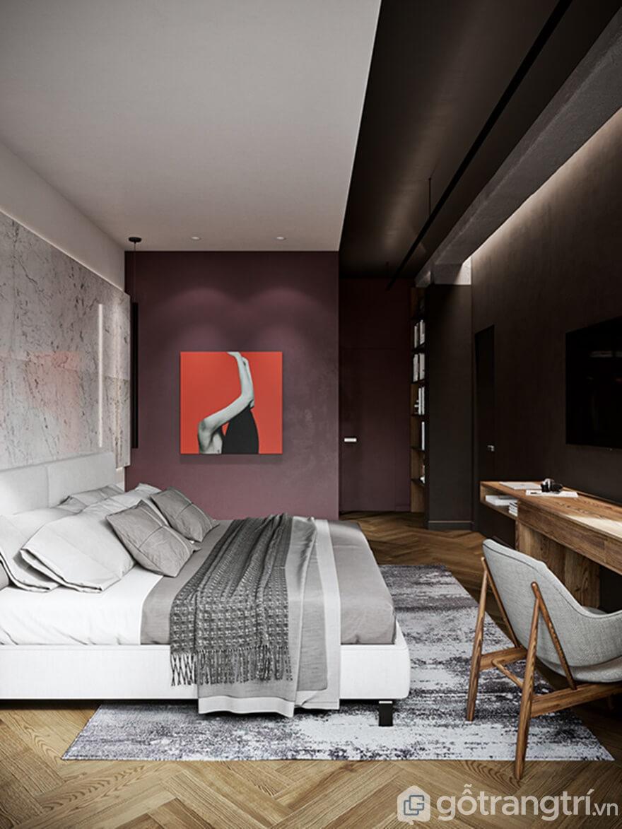 1 góc mảng tường sơn màu tím với bức tranh treo tường nhìn rất nghệ thuật